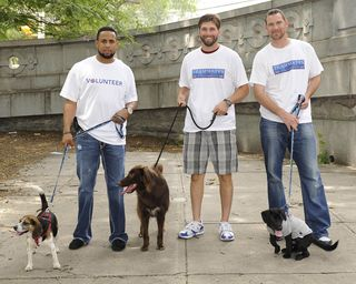 Francisco Rodriguez Jeff Francoeur and Mike Pelfry Standing with Dogs Outside